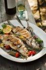 Whole Grilled Stuffed Branzino Fish — Stock Photo