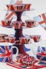 Union Jacks on cupcakes on cake stand — Stock Photo