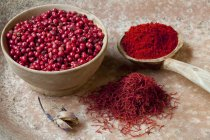 Peppercorns with saffron threads and paprika — Stock Photo