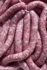 Raw Bratwurst sausages — Stock Photo