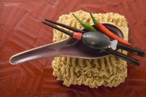 Dried egg noodles and soup spoon — Stock Photo
