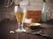 Glass of Beer with Nuts — Stock Photo