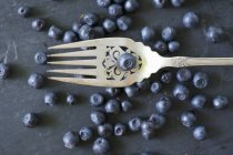 Blueberries with vintage fork — Stock Photo