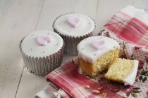 Cupcakes decorated with hearts — Stock Photo