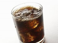 Closeup view of Dandelion and Burdock cocktail with ice cubes — Stock Photo