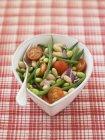 Bean, onion and tomato salad in white dish — Stock Photo