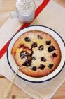 Closeup top view of blackberry Clafoutis with icing sugar — Stock Photo