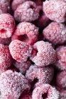 Frozen raspberries in heap — Stock Photo