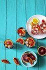 Elevated view of iced Spritz veneziano with blood oranges and lemon — Stock Photo
