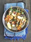 Salmon skewers with courgettes — Stock Photo
