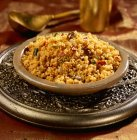 Spicy couscous with raisins and sunflower seeds — Stock Photo