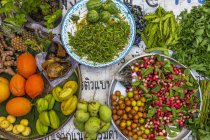 Exotic fruits at a street market stand — Stock Photo