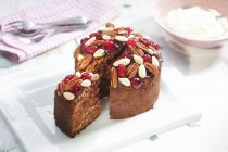 Cake with nuts and glace cherries — Stock Photo