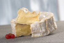 Partly sliced Camembert cheese — Stock Photo