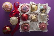Christmas cupcakes and petit fours — Stock Photo