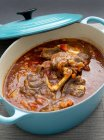 Osso buco in pot — Stock Photo