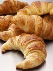 Stack of fresh and sweet croissants — Stock Photo