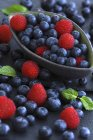 Blueberries and raspberries in a bowl — Stock Photo