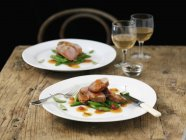 Pork saltimbocca over table — Stock Photo