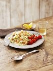 Seafood risotto with tomatoes — Stock Photo
