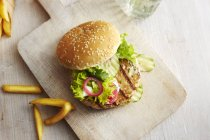 Chicken burger and potato fries — Stock Photo