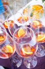 Elevated view of Aperol in wine glasses with orange slices — Stock Photo