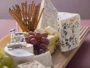 Cheese board with grapes — Stock Photo