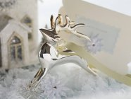 Silver reindeer and Christmas card — Stock Photo
