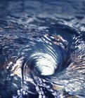 Closeup view of swirling water surface — Stock Photo