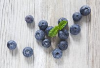 Blueberries and mint leaves — Stock Photo