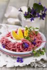 Beetroot linguine pasta with boiled eggs — Stock Photo