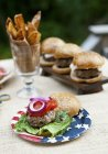 Elevated view of grilled buffalo burgers in wholemeal buns on an outdoor table — Stock Photo