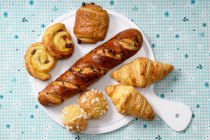 Top view of pains aux raisins with chouquettes and croissants — Stock Photo