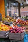 Daytime view of various types of apples on market stall — Stock Photo