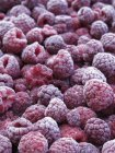 Heap of frozen raspberries — Stock Photo