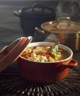 Minestrone with chickpeas and basil leaves — Stock Photo