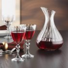 Carafe and glasses of red wine on table — Stock Photo