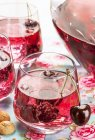 Cherry and amaretto punch in glasses and jug — Stock Photo