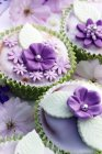 Muffins decorated with glace icing — Stock Photo