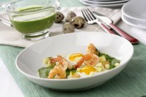 Creamed spinach and apple shrimp on white plate — Stock Photo