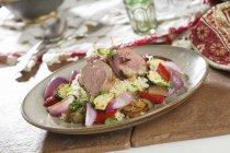 Cuscus con verdure e filetto di maiale — Foto stock