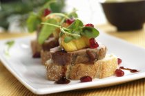 Pork canape with pineapple — Stock Photo