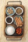 Assorted spices in bowls on a tray — Stock Photo