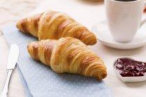 Croissants with raspberry jam — Stock Photo