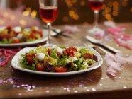 Tomato and mozzarella salads on plates — Stock Photo