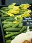 Fresh courgettes with flowers — Stock Photo