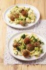 Orecchiette pasta with pork meatballs — Stock Photo
