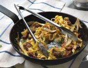 Tagliatelle pasta with sausage — Stock Photo