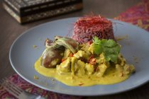 Lamb and coconut curry with red rice — Stock Photo