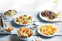 Various starters in bowls — Stock Photo